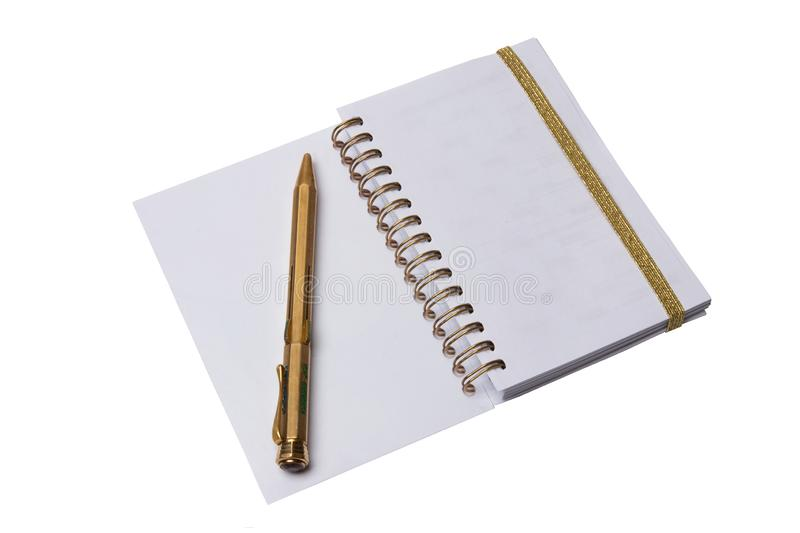 Notebook and pen. A open notebook with blank pages and an antique golden color pen isolated on a white background. stock photos
