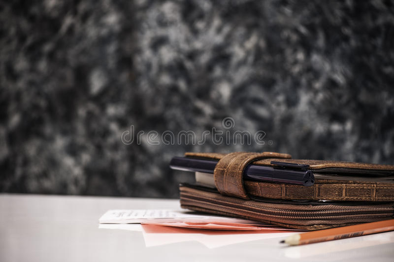 Notebook pen, pencil and sheets stock photos