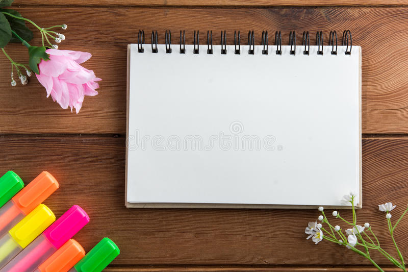 Notebook with a pen wooden floor highlights. royalty free stock images