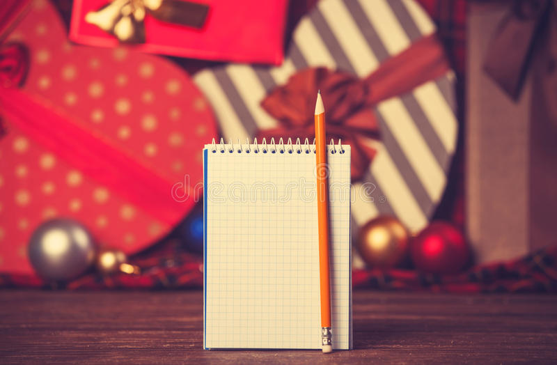 Notebook and pencil. With christmas gifts royalty free stock photos