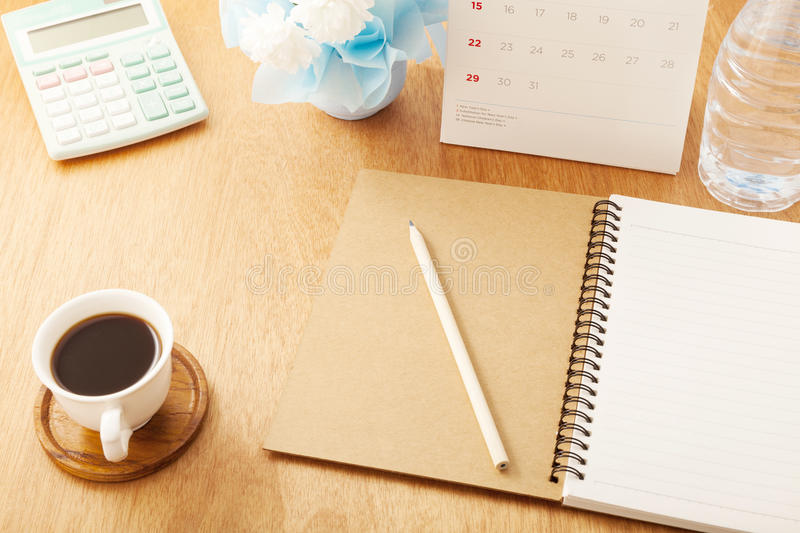 notebook with pencil,coffee cup,calendar,calculator,bottle water royalty free stock photos