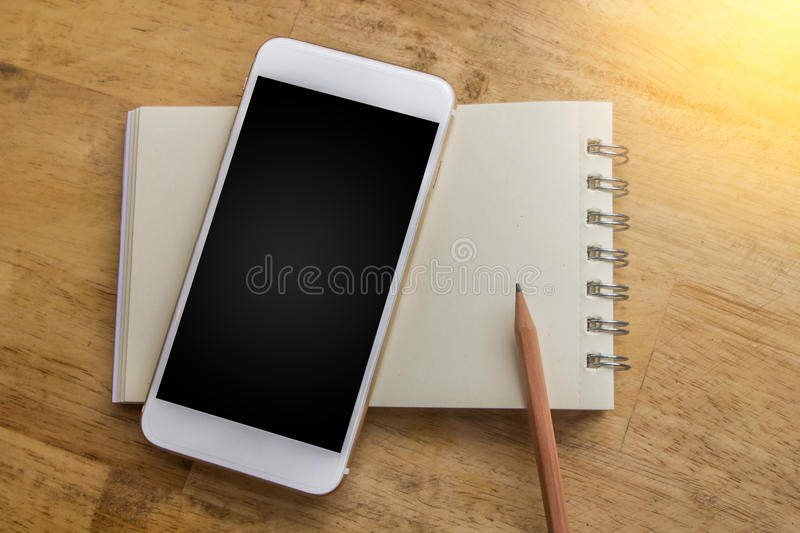 Notebook with pencil concept to bring in new planning and free t royalty free stock images