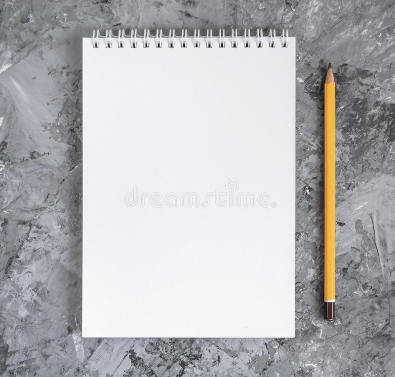 Notebook with a pencil on a concrete background stock images