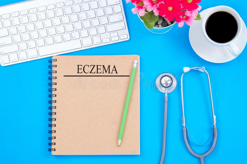 Notebook and pencil with ECZEMA word on the table with stethoscope, Skin diseases concept royalty free stock image
