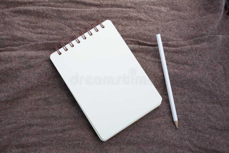 Notebook and pencil. Opened notebook and white pencil royalty free stock photography