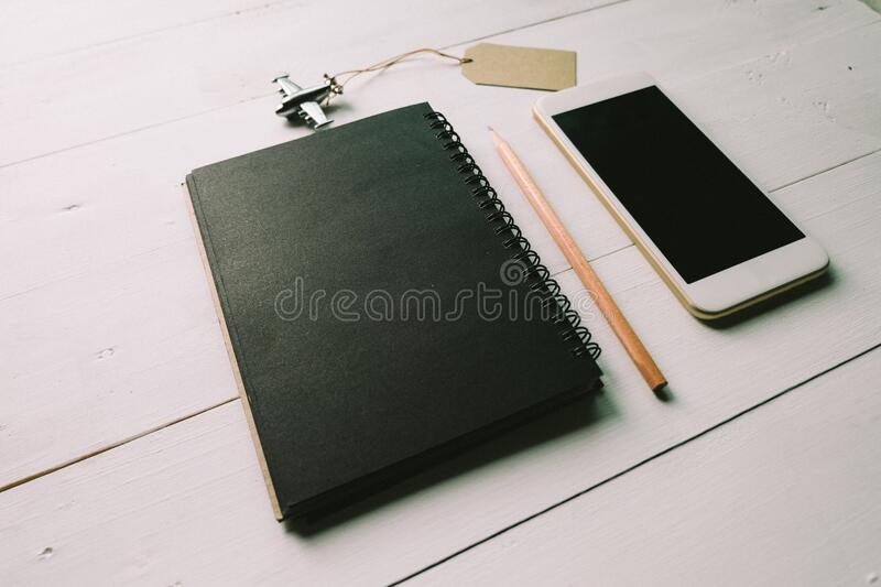 Notebook phone and airplane stock photo