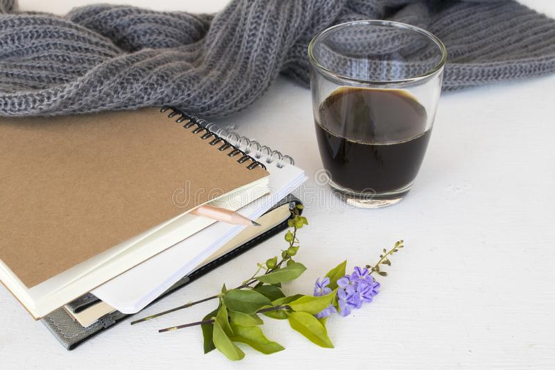 Notebook planner for business work and coffee. Notebook planner for business work with hot black coffee ,flower decoration flat lay style on background white royalty free stock photos