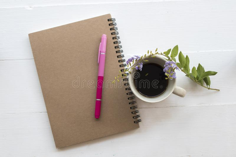 Notebook planner for business work at office. Notebook planner for business work with hot coffee decoration flat lay style stock image