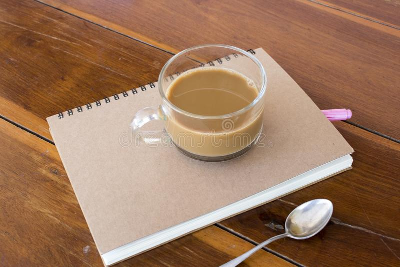 Notebook planner for business work at office. Notebook planner for business work with hot coffee decoration on table at office desk royalty free stock photo