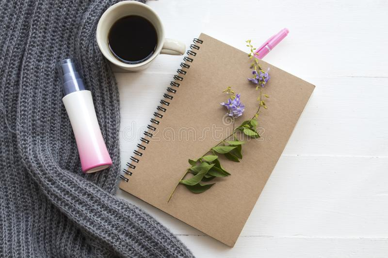 Notebook planner for business work at office. Notebook planner for business work with spray and knitting wool scarf of lifestyle woman in winter season stock photos