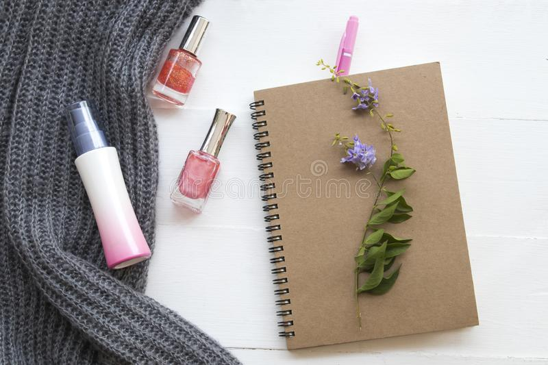 Notebook planner for business work at office. Notebook planner for business work with spray ,nail polish and knitting wool scarf of lifestyle woman in winter royalty free stock images