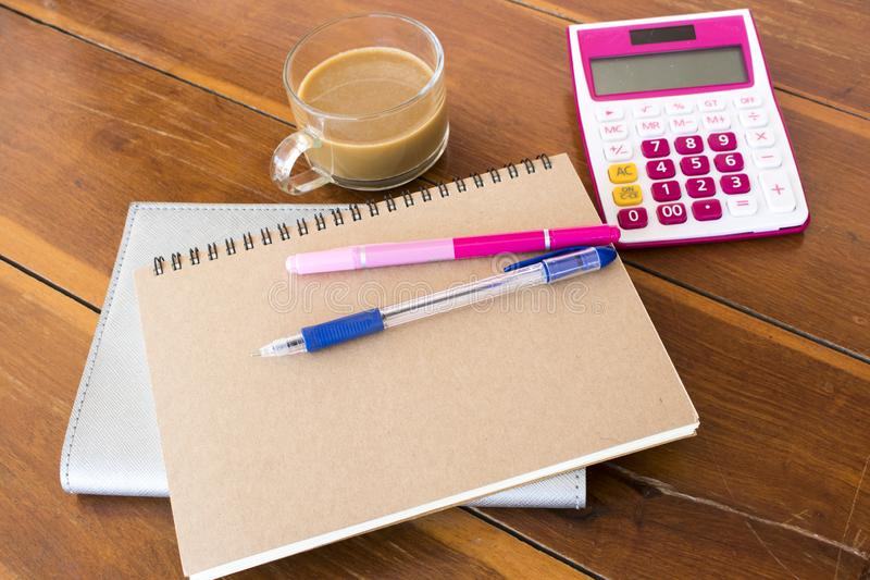 Notebook planner ,calculator for business work. With hot coffee decoration on table at office desk stock image