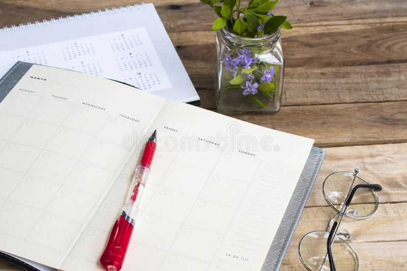 Notebook planner with calendar for business work arrangement flat lay style royalty free stock photos
