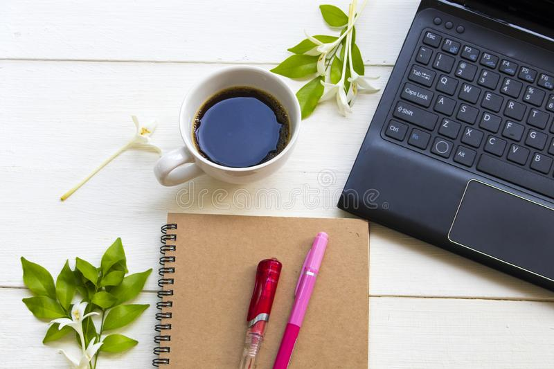 Notebook planner ,computer for business work with hot coffee espresso of lifestyle royalty free stock photo