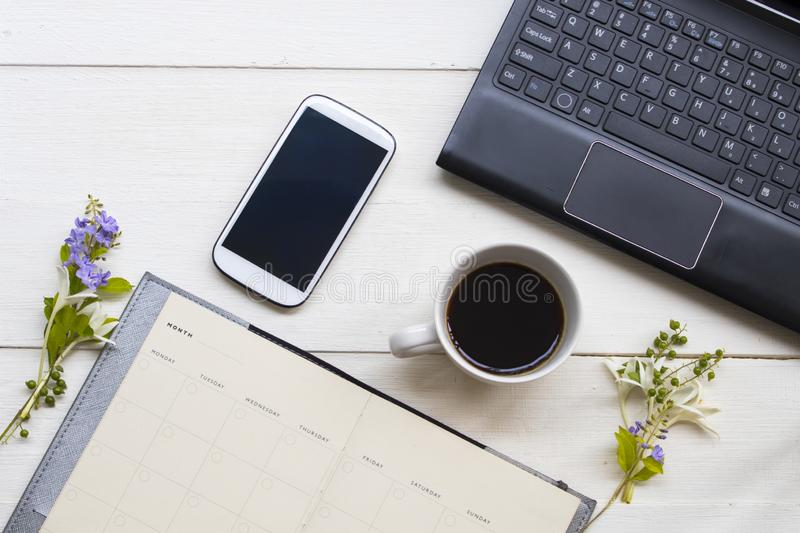 Notebook planner ,computer ,mobile phone for business work with hot coffee espresso of lifestyle stock photos