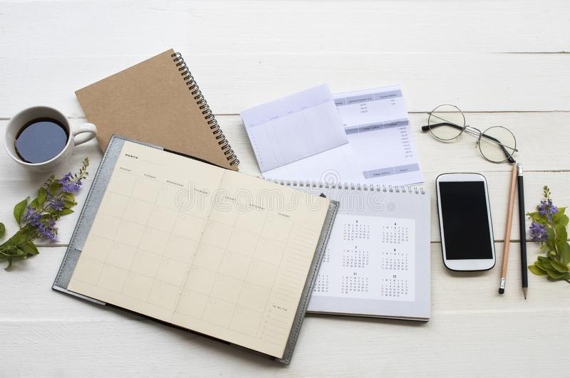 Notebook planner and document expenses of credit card for check stock images