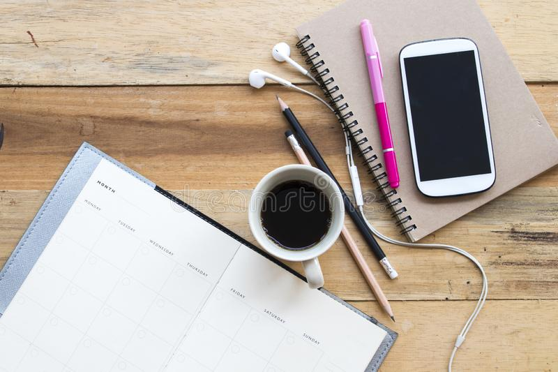 Notebook planner ,mobile phone for business work at office royalty free stock photo