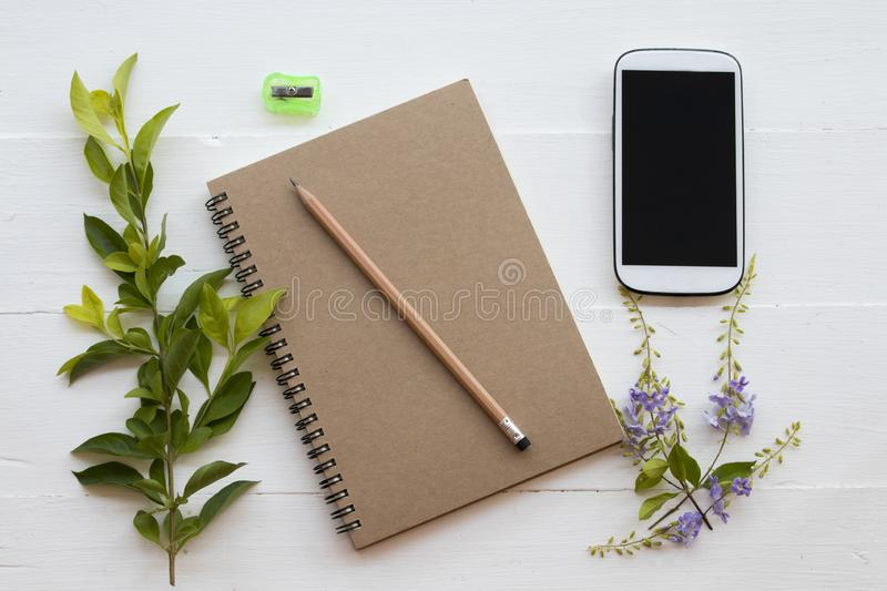 Notebook planner with pencil arrangement on white. Notebook planner ,pencil and sharpener arrangement flat lay style on background white royalty free stock photography