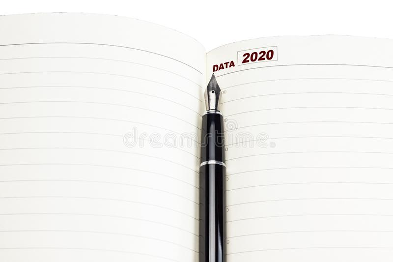Notebook for planning, pen, inscription 2020 sur fond blanc photographie stock libre de droits