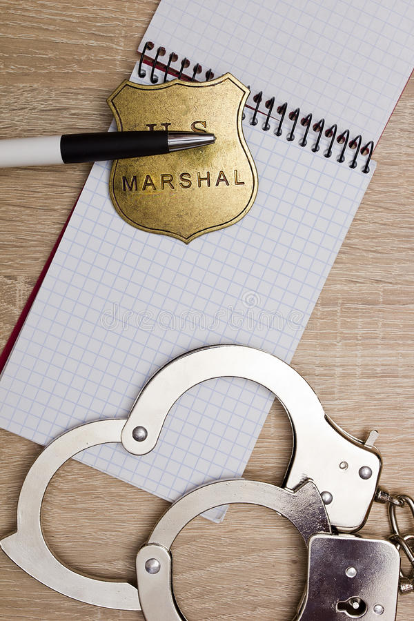Notebook police detective. With handcuffs and a marshal's badge royalty free stock images