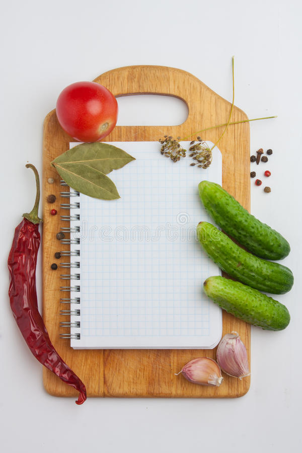 Notebook with recipes. And shopping list in the kitchen royalty free stock image