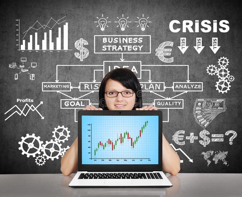 Notebook with stock chart on screen. Businesswoman holding notebook with stock chart on screen stock photo
