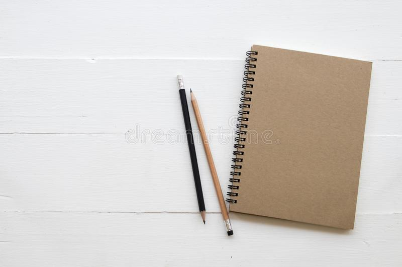 Notebook of student writing note for study. Notebook ,pencil of student writing note for study decoration flat lay style on background white wooden stock photo