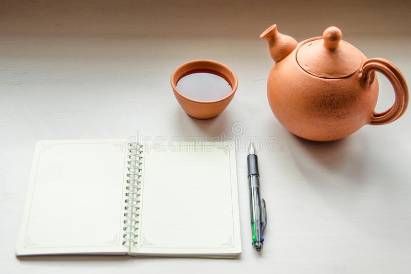 A notebook and a teaset stock photography