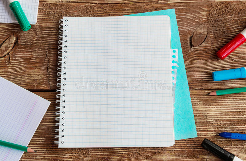 Notebook template mock up on a wooden table. royalty free stock photography