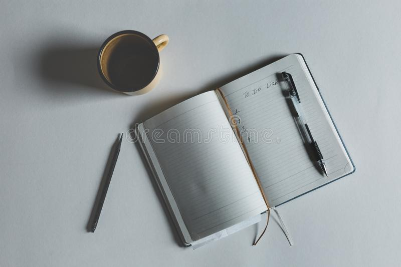 Image Of Open Notebook With Text To Do List Next To Cup Of Coffee on top view royalty free stock image