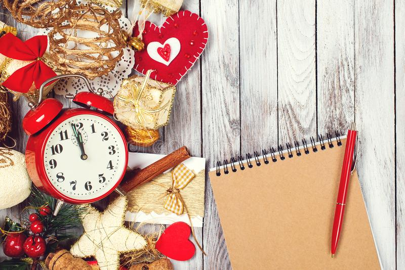 Notebook for to do list and goals about new year. Christmas composition with festive decoration and vintage alarm clock. Xmas. Noe stock photos