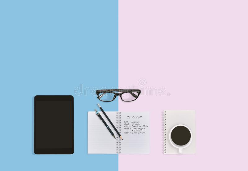 Notebook with notes, tablet eyeglasses and a cup of coffee on the desktop workplace with copy space. Notebook with to do list notes, pen, pencils, tablet royalty free stock photos