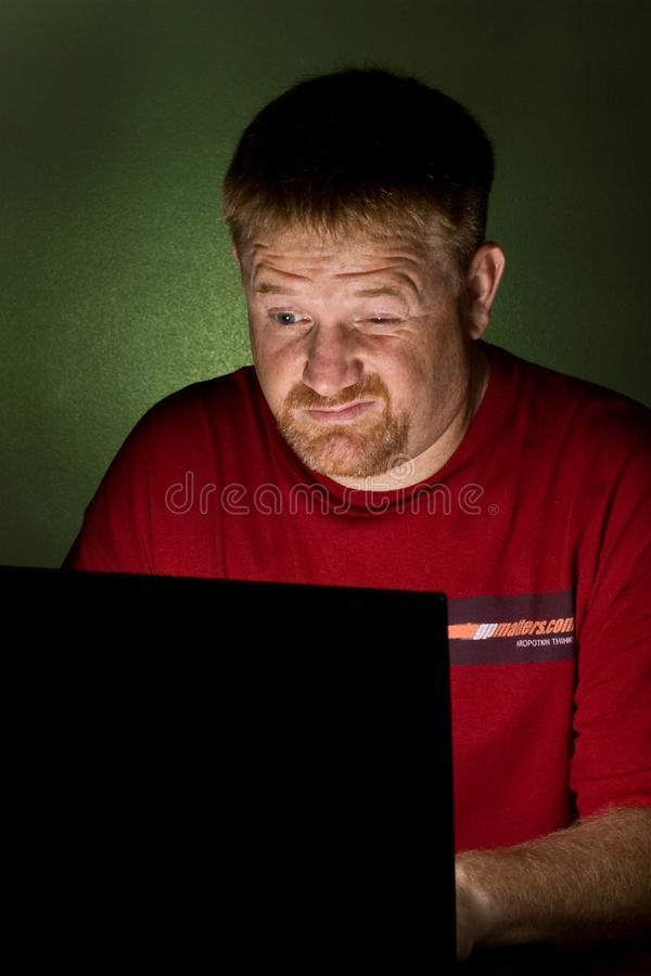 Notebook User Looking Tired royalty free stock photography