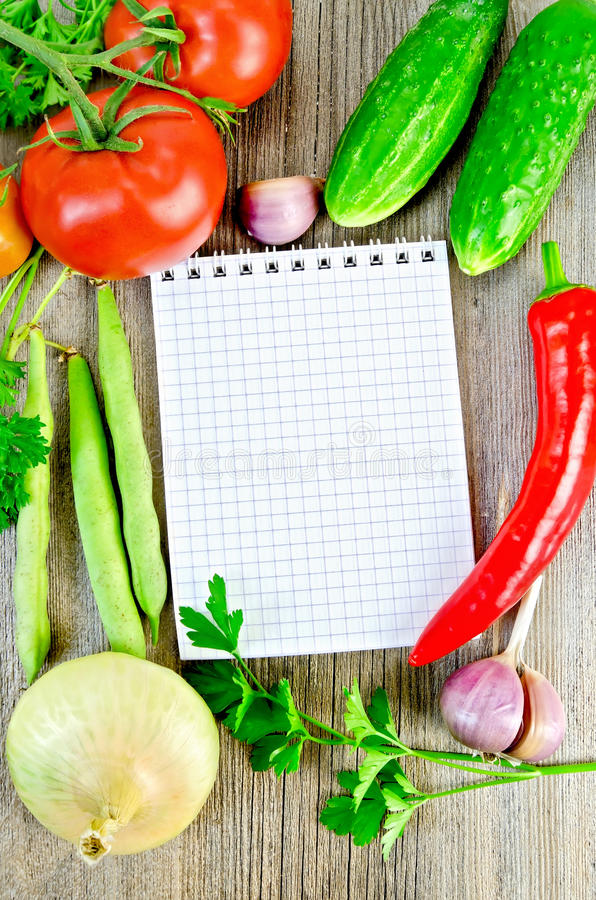 Notebook with vegetables and parsley stock image