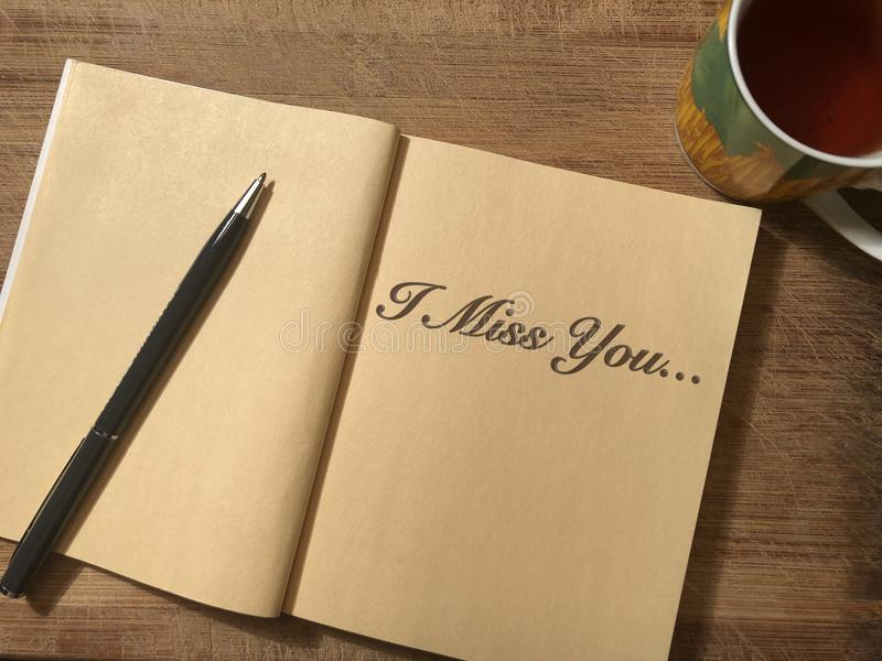 Notebook which is I Miss You written on it stock photos