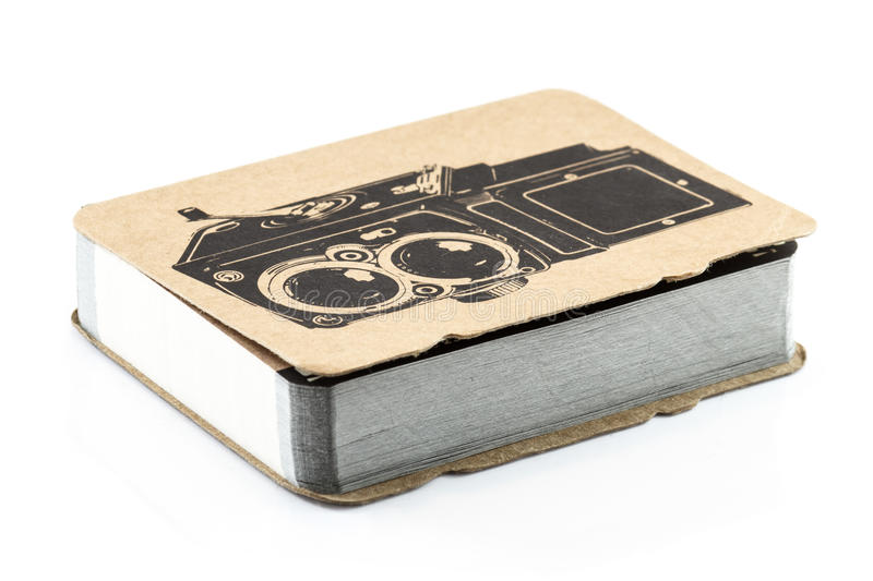 Notebook. On white background with old camera cover royalty free stock image