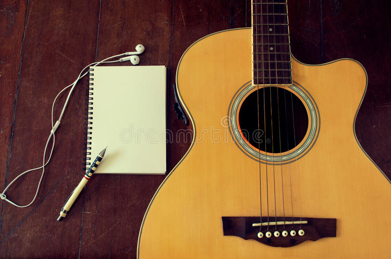 Notebook and wooden pencil on guitar royalty free stock photo