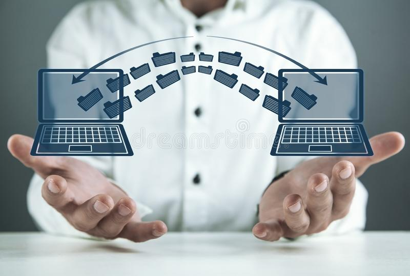 Notebooks file transfer. Concept of information exchange stock photo