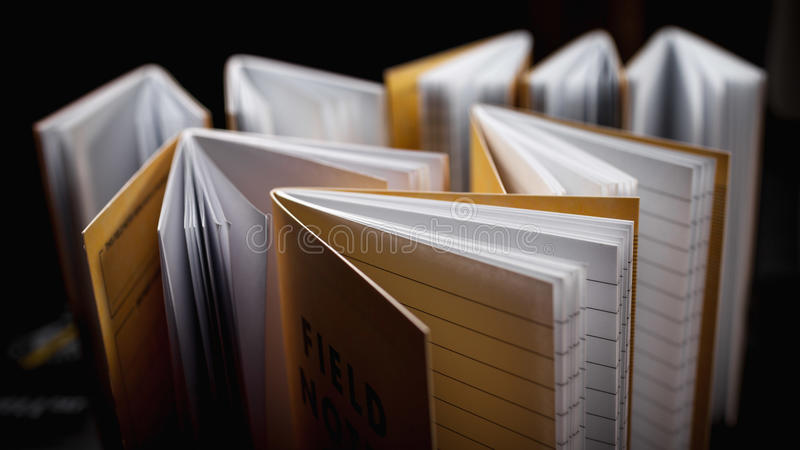 Notebooks with lined pages. Plain brown notebooks open with lined blank pages stock photos