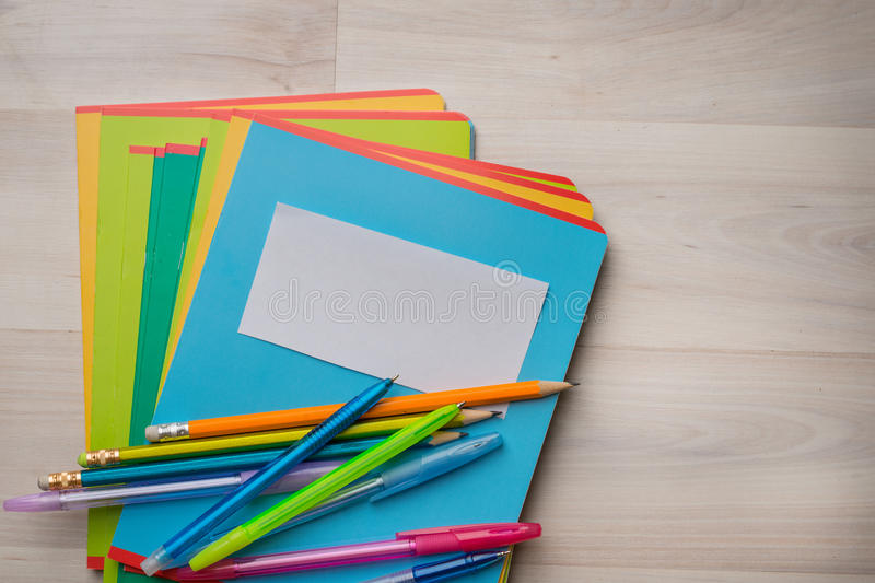 Notebooks and pens. With pencils royalty free stock images
