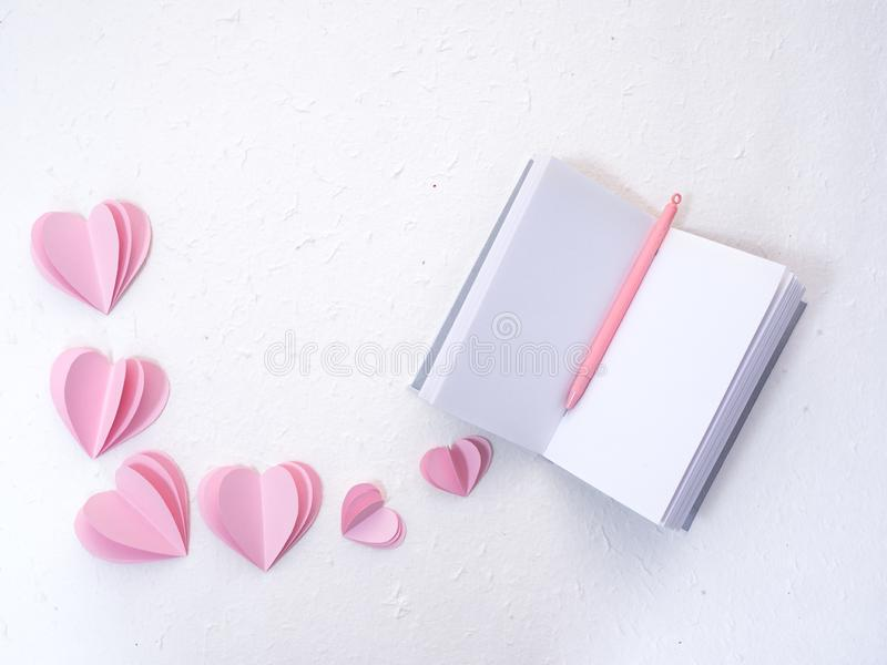 Notebooks with pink paper hearts royalty free stock photos