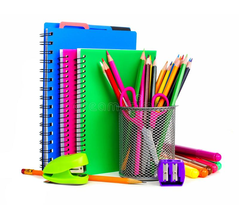 Notebooks and school supplies. Group of colorful school notebooks and supplies over a white background stock photo