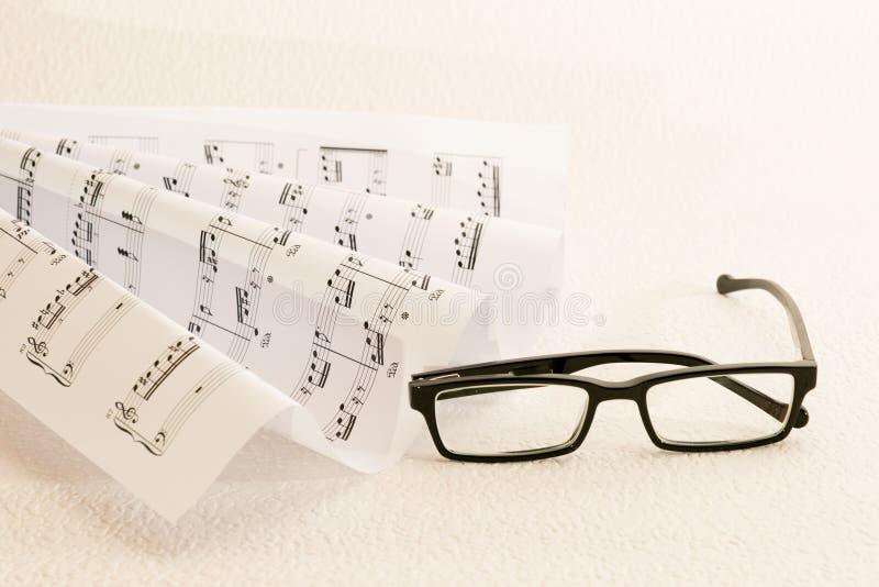 Noten ein Gläser lizenzfreies stockbild