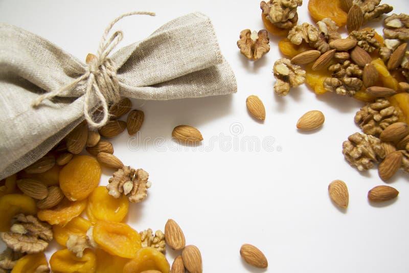 Noten met geverfte abrikozen en choco royalty-vrije stock afbeelding