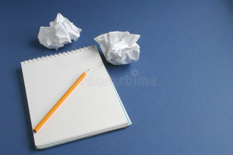 Notepad on blue stock images