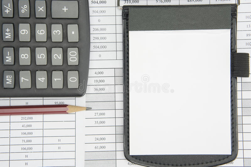 Notepad and brown pencil with calculator on finance account stock photography