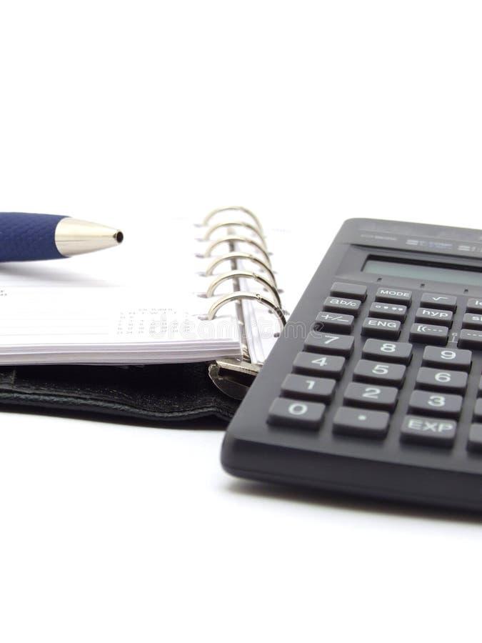 Notepad and calculator stock photos