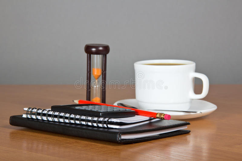 Notepad, calculator and cup of coffee stock image