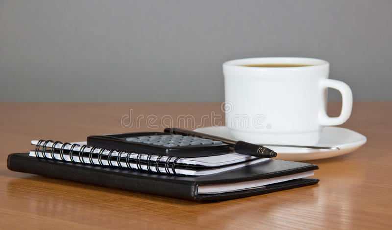 Notepad the calculator, cup of coffee royalty free stock photos