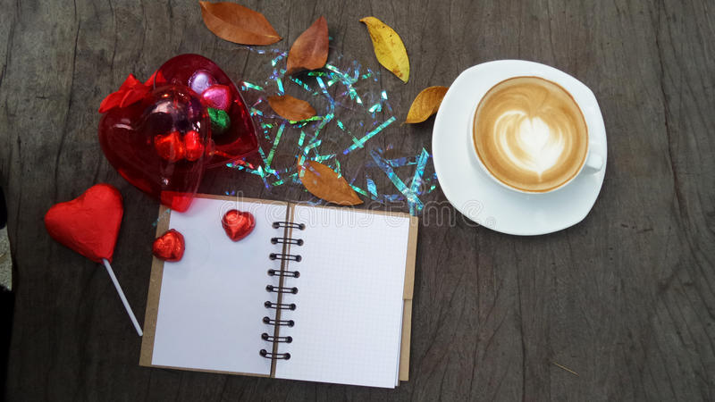 Notepad, computer and coffee cup on office wooden table, top view stock images